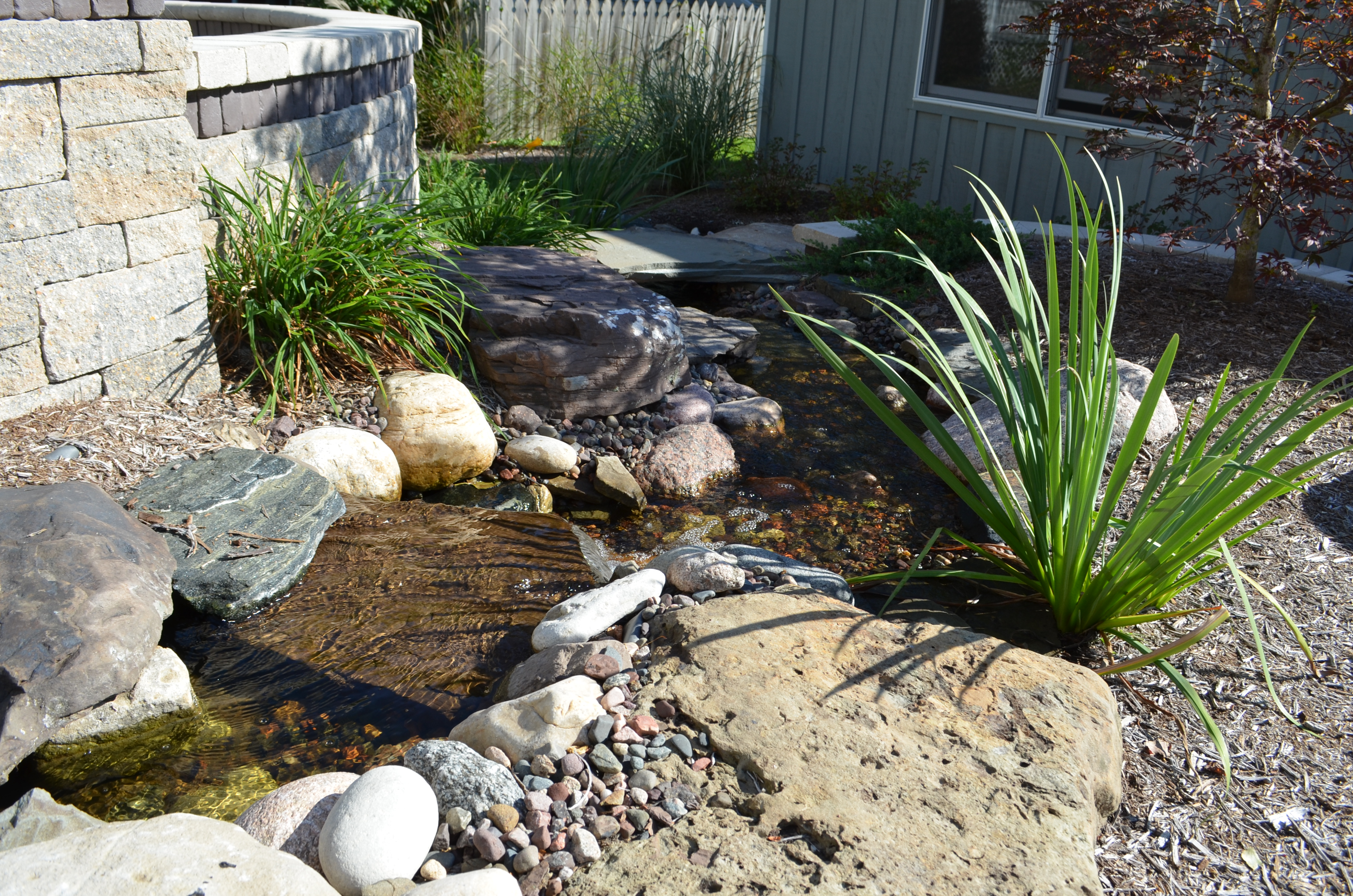 creating backyard atmosphere with water features